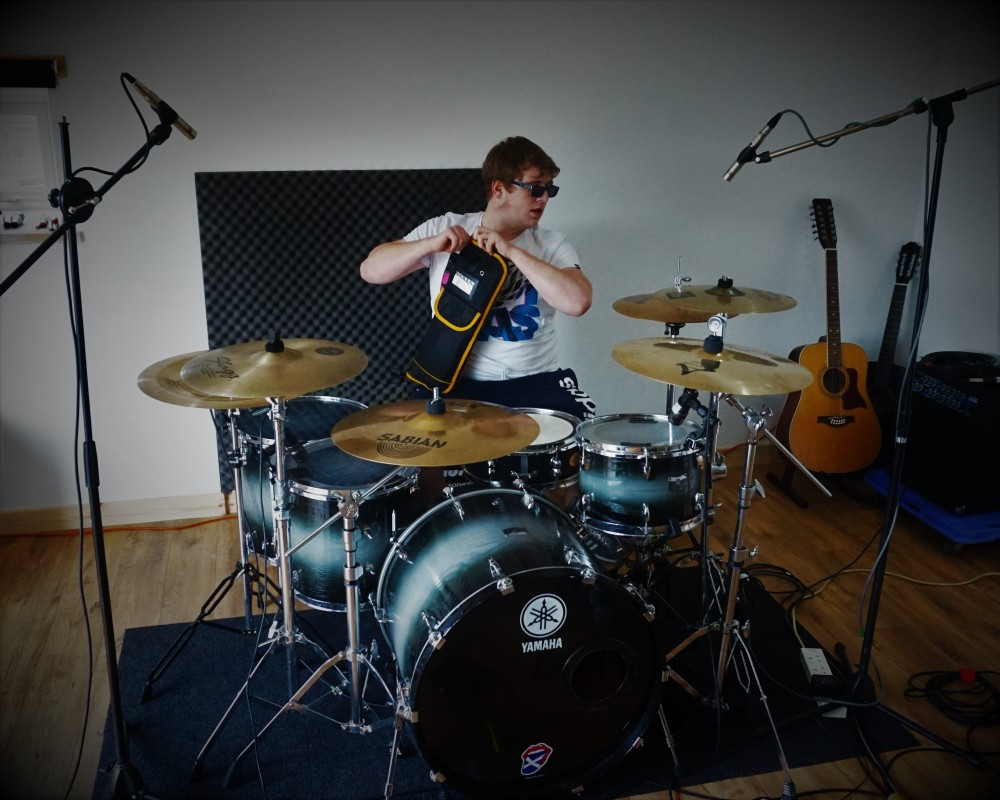 Liam on drums.